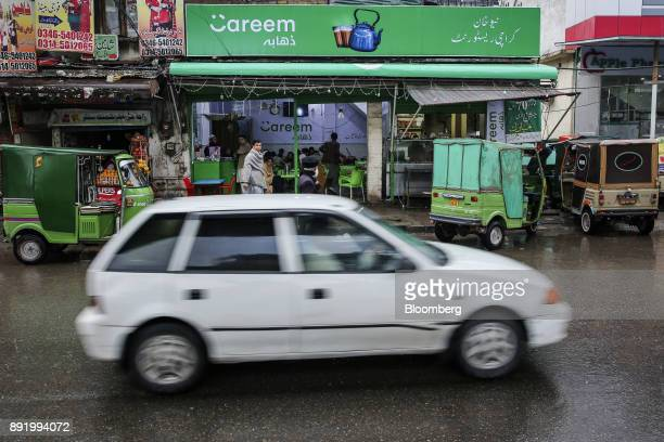 A car travels past a Careem Inc cafe on Murree Road in Rawalpindi Pakistan on Tuesday Dec 12 2017 Ridehailing company Careem plans to expand across...