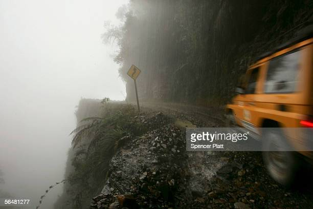 A car travels the road connecting the city of La Paz to the Coroico in the North Yungas December 21 2005 in the Yungas Bolivia Referred to as the...