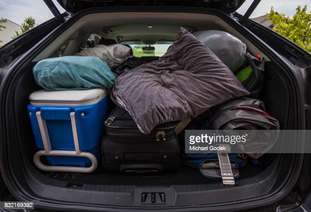 Car truck packed with luggage and other items for road trip