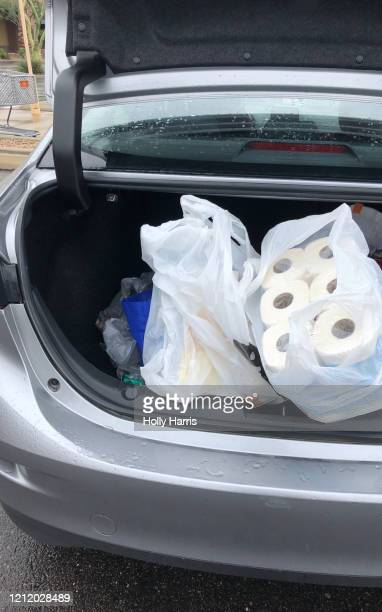 car trunk of stocking up on toilet paper (for coronavirus pandemic) - buying toilet paper stock pictures, royalty-free photos & images
