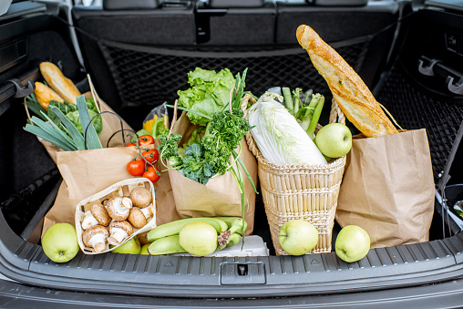 Car trunk with shopping bags and products 1146849181