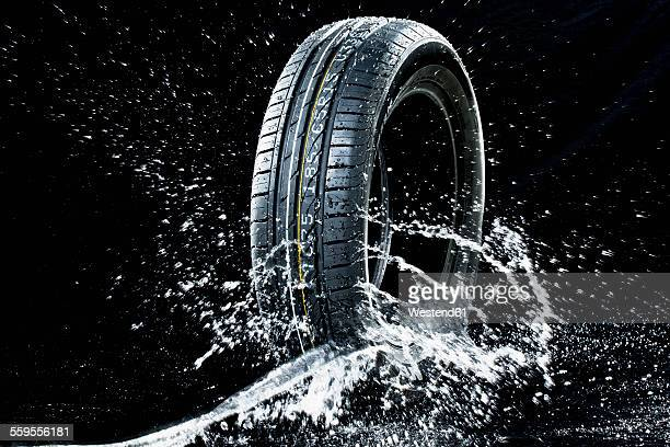 Car tyre in wetness