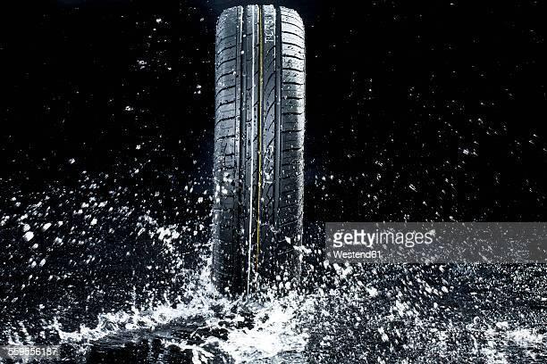 Car tyre in wetness