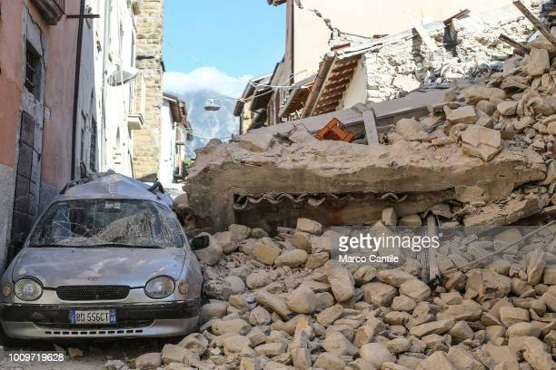 A car under the rubble of a house completely collapsed after the earthquake that hit the city of Amatrice in central Italy