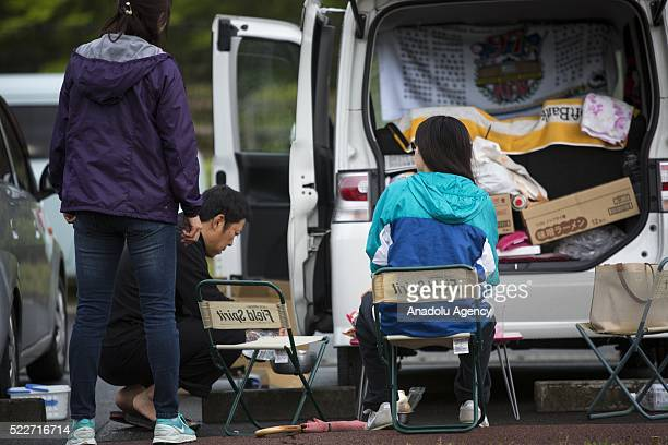 A car used for temporary shelter by earthquake survivors is seen early in the morning of April 21 2016 in Mashiki Gymnasium parking area Kumamoto...