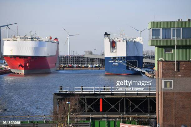 Car vessels lie in the port on March 19 2018 in Bremerhaven Germany The new German government is seeking to prevent new tariffs between the European...
