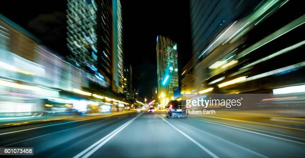 POV car view of city streets at night