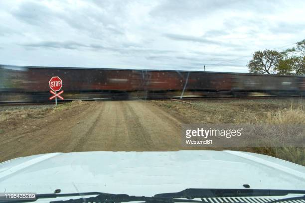 car waiting for a train to pass, kwazulu-natal, south africa - railroad crossing stock pictures, royalty-free photos & images