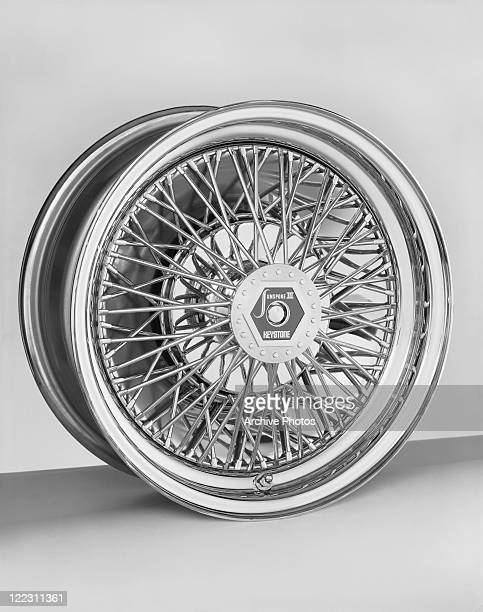 Car wheel against white background, close-up