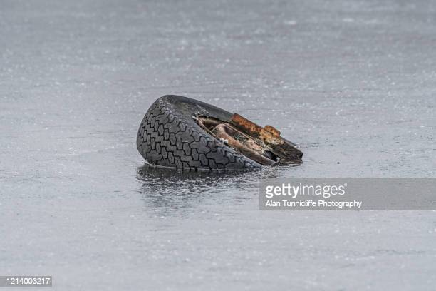 car wheel in ice - wheel stock pictures, royalty-free photos & images
