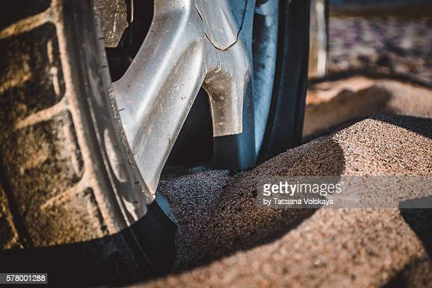 car wheel stuck in the sand