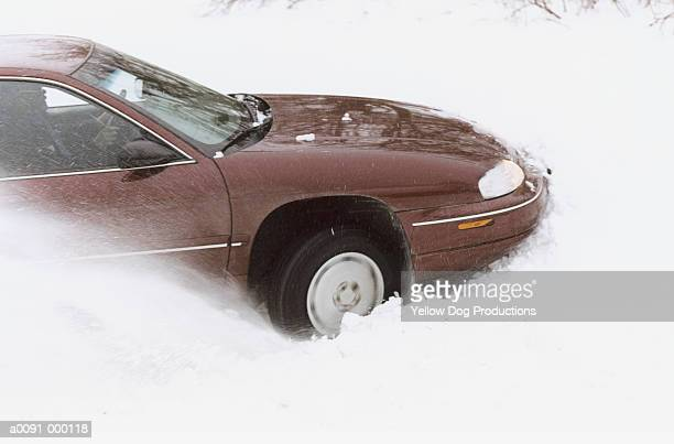 Car Wheels Spinning in Snow