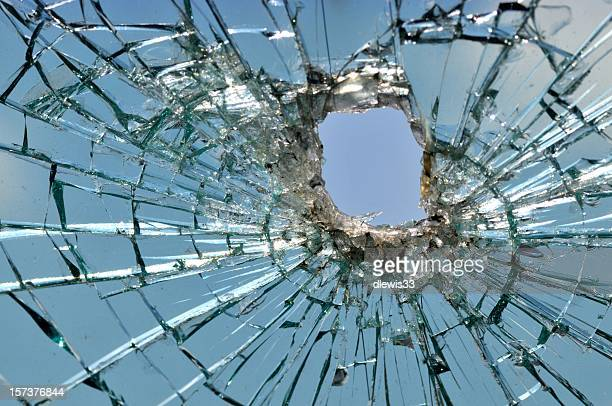 Car windshield shattered by a bullet