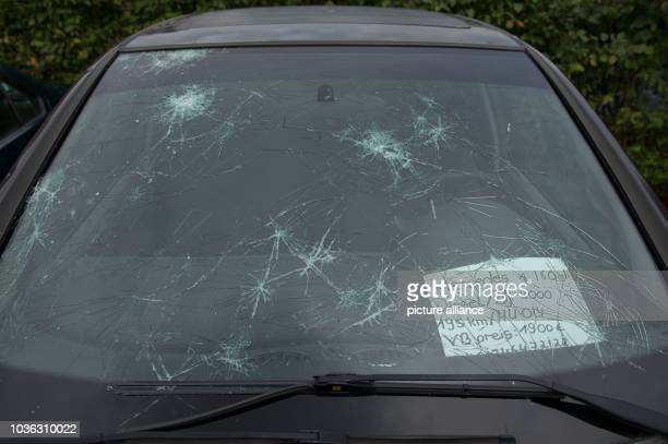 A car with a broken front window destroyed by hail stands at a car trader in Sehnde Germany 29 July 2013 A violent storm with hail tracked over the...