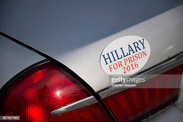 A car with a bumper sticker reading HILLARY FOR PRISON 2016 parked outside the campaign headquarters of Republican presidential candidate Sen Ted...