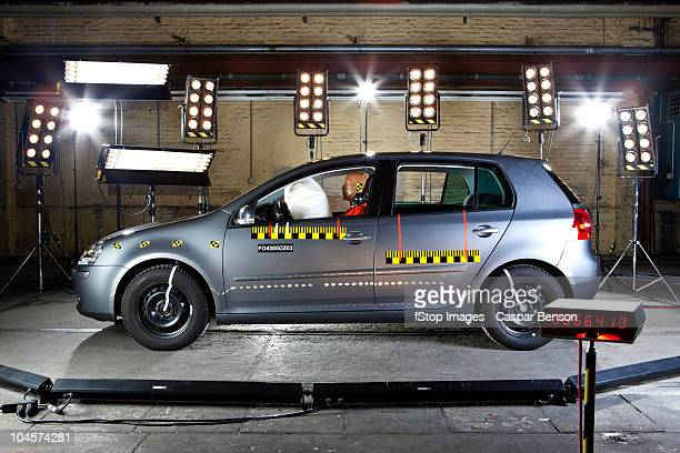 A car with a crash test dummy in a crash test laboratory
