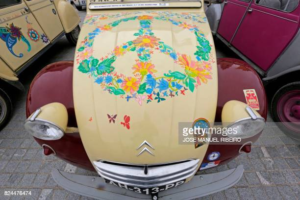 Car with a handicrafted painting is pictured in the parking area in Mafra after the parade of the World 2017 2CV Meeting July 30, 2017. - The event...