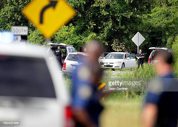 A car with bullet holes sits along LA 3217 after two St John the Baptist sheriff's deputies were killed and at least one other injured in a shoot out...