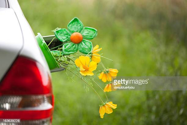 Car with flowers in the tank lid - Renewable energy