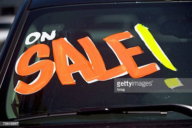 Car with On Sale on windshield
