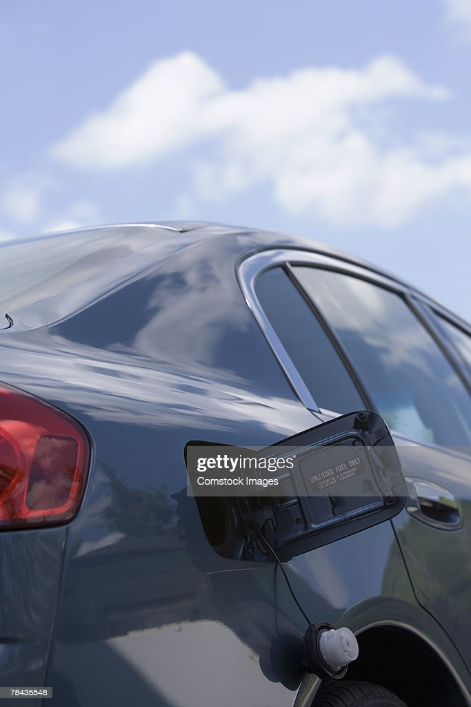 Car with open fuel tank : Stockfoto