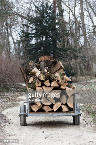 Car with pile of firewood
