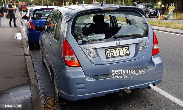TOPSHOT A car with shattered windows is parked close to the mosque after a gunman filming himself firing at worshippers inside in Christchurch on...