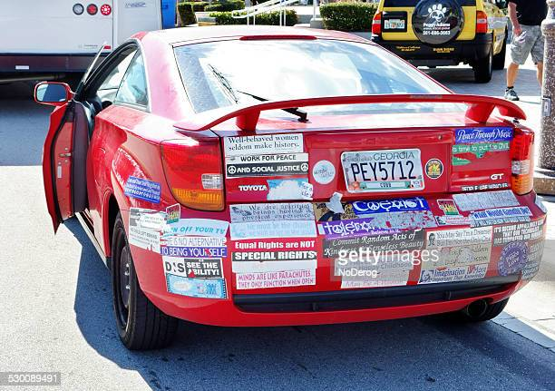 car with socially responsible bumper stickers - bumper sticker stock photos and pictures