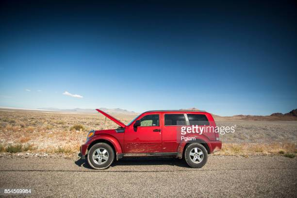 Car with the hood open on the side of the salt flats in Utah USA