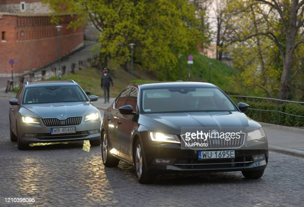 A car with the leader of the Law and Justice party Jaroslaw Kaczynski seen at the entrance to Wawel Castle as he attends a mass commemorating the...
