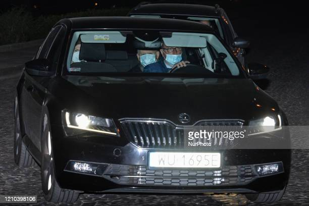 A car with the leader of the Law and Justice party Jaroslaw Kaczynski leaves Wawel Castle after they attended a mass commemorating the 10th...