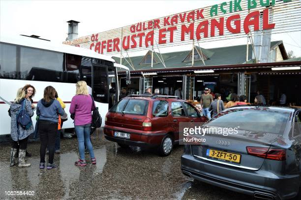 A car with The Netherlands plates is parked as travelers wait outside a roadside restaurant in Bolu Turkey on October 20 2018 Bolu is located along a...