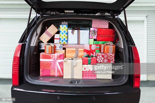 car with trunk full of gifts - full stock pictures, royalty-free photos & images