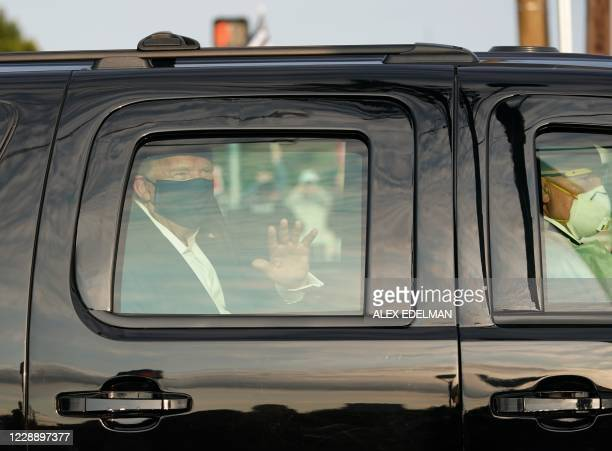 Car with US President Trump drives past supporters in a motorcade outside of Walter Reed Medical Center in Bethesda, Maryland on October 4, 2020.