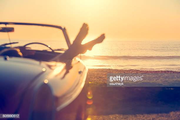 car with womans feet hanging out of the window - only young women stock pictures, royalty-free photos & images