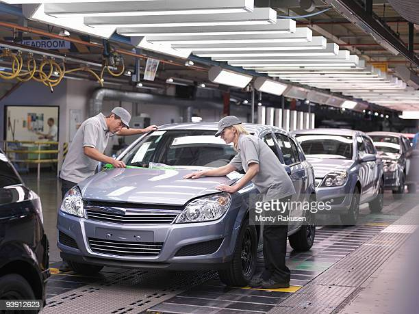Car Workers Inspecting Finished Cars