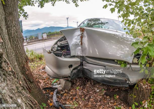 car wreck off the road after a fatal accident - fatal car accident stock pictures, royalty-free photos & images