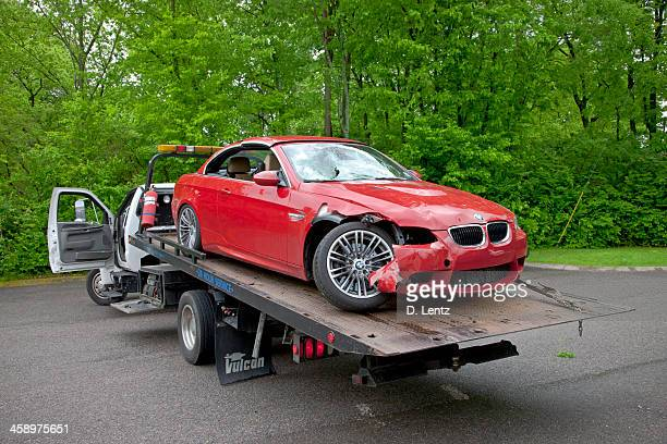 bmw car wreck - tow truck stock photos and pictures