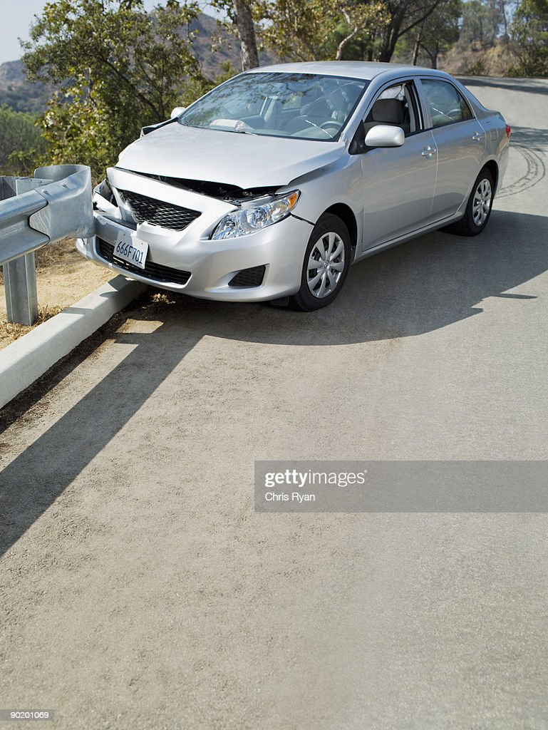 Car wrecked on road guardrail : Stock Photo