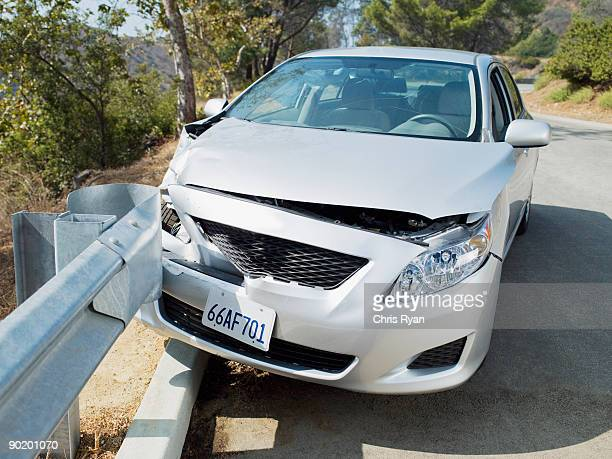 wrecked Car on road guardrail