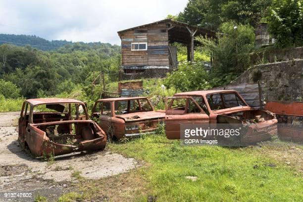 TSKVARCHELI TKVARCHELI ABKHAZIA GEORGIA Car wrecks in the abandoned Soviet coal mining city of Tkvarcheli Abkhazia is a partially recognized state...