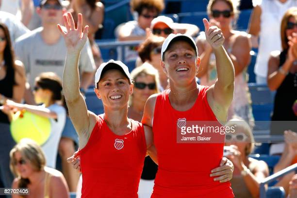 Cara Black of of Zimbabwe and Liezel Huber of the United States wave to the crowd after defeating Lisa Raymond of the United States and Samantha...