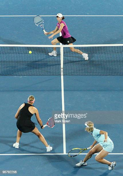 Cara Black of the USA prepares to volley in her womens doubles final match with Liezel Huber of the USA against Nadia Petrova of Russia and Tathiana...