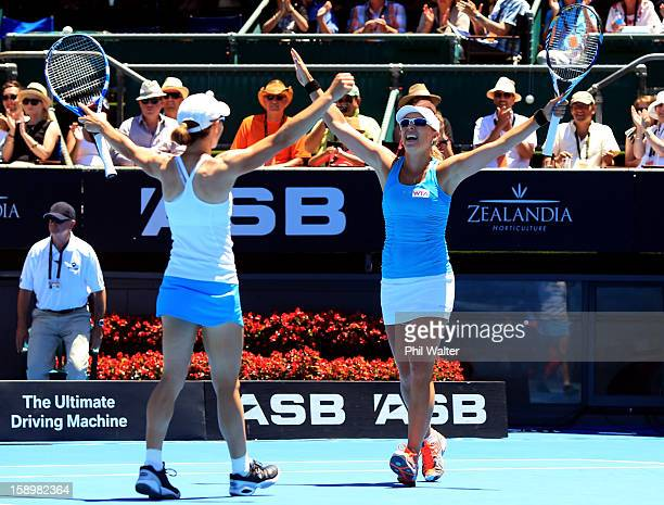 Cara Black of Zimbabwe and Anastasia Rodionova of Australia celebrate their doubles final win against Julia Goerges of Germany and Yaroslava Shvedova...