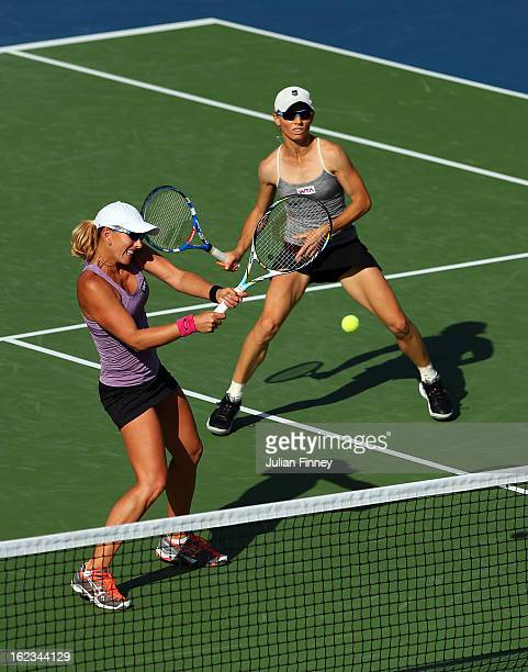 Cara Black of Zimbabwe and Anastasia Rodionova of Australia in action in their doubles semi final match against Bethanie Mattek-Sands of USA and...