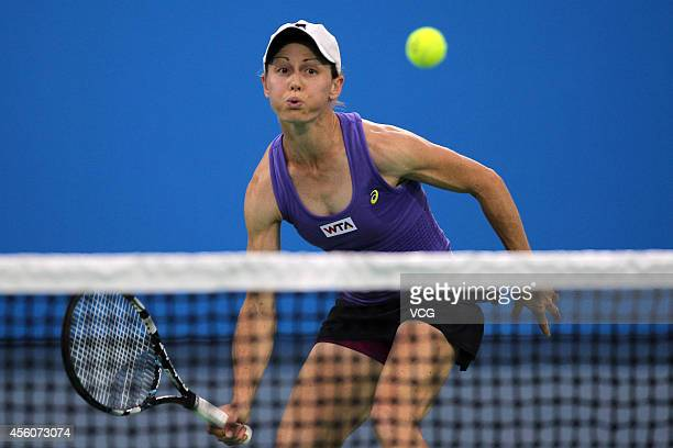 Cara Black of Zimbabwe and Caroline Garcia of France compete with Sara Errani of Italy and Roberta Vinci of Italy during day five of the 2014...