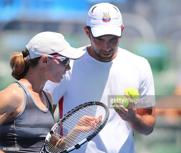 Cara Black of Zimbabwe and Juan Sebastian Cabal of Colombia talk tactics in their first round mixed doubles match against Yung-Jan Chan of Chinese...