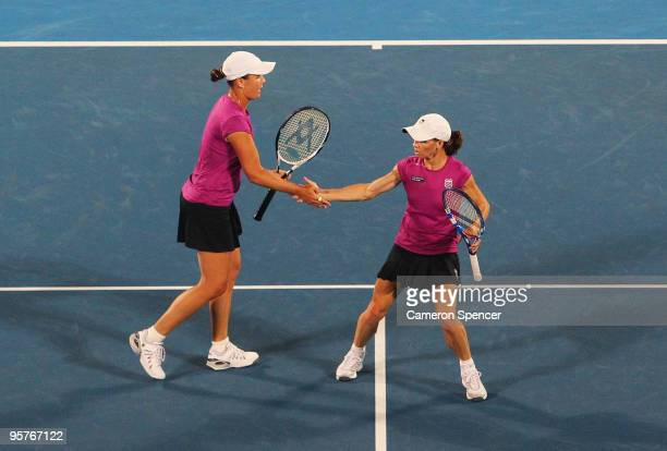 Cara Black of Zimbabwe and Liezel Huber of the USA celebrate a point during their womens doubles match against Laura Granville of the USA and Abigail...