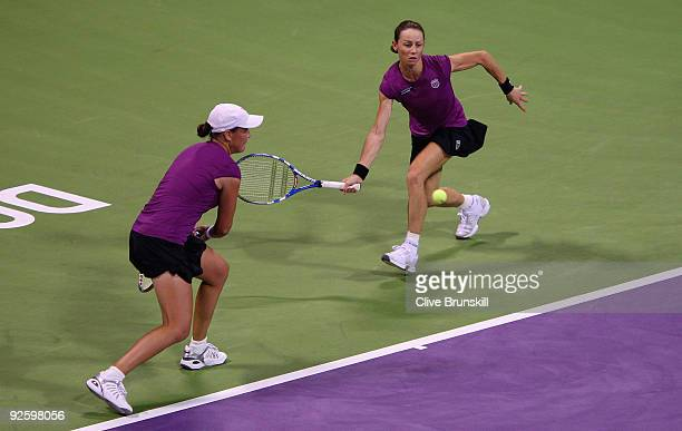 Cara Black of Zimbabwe and Liezel Huber of the USA in action against Nuria Llagostera Vives and Maria Jose Martinez Sanchez of Spain in the Womens...