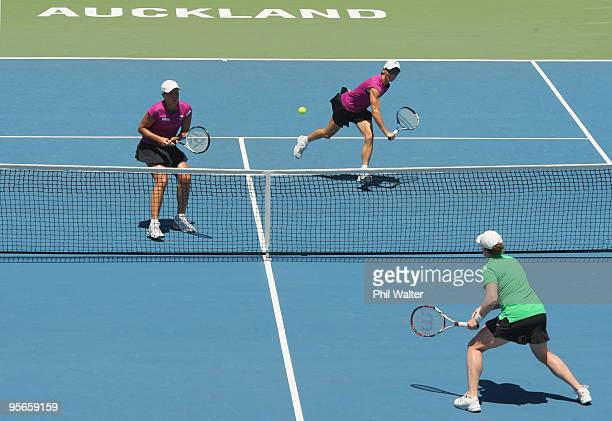 Cara Black of Zimbabwe and Liezel Huber of the USA volley at the net during their doubles final against Natalie Grandin of South Africa and Laura...